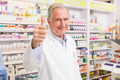 Positive pharmacist with thumb up Stock Photos