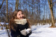 A little girl in a park with paper cranes. A positive photo representing a concept of coming spring - a laughnig little girl in a park with paper cranes Stock Photography