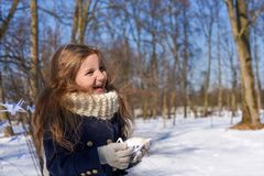 A little girl in a park with paper cranes. A positive photo representing a concept of coming spring - a laughnig little girl in a park with paper cranes Royalty Free Stock Photography