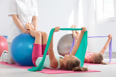 Positive physiotherapy session for kids stock photography