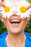 Positive portrait with camomile Royalty Free Stock Images