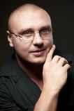 Positive portrait of serious man in eyeglasses Stock Photos
