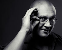 Positive portrait of serious man in eyeglasses Royalty Free Stock Photo
