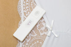 Positive pregnancy test on the woman belly Stock Images