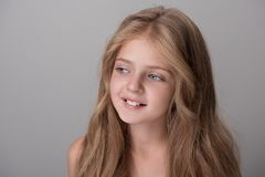 Positive pretty child is standing happily stock photography