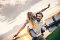 Positive pretty couple entertaining in open air stock photos