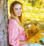 Positive pretty girl having fun in autumn park Royalty Free Stock Images