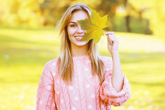 Positive pretty woman having fun in sunny autumn park Royalty Free Stock Photo