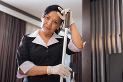 Positive professional chambermaid looking at you Royalty Free Stock Photo
