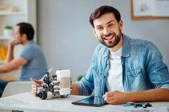 Positive professional engineer testing robot stock photos