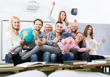 Positive professor and group of students. At extension courses Royalty Free Stock Images