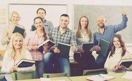 Positive professor and group of students Stock Image