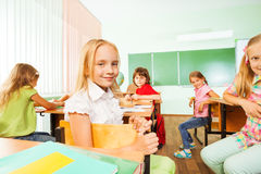 Positive pupils turned back of the class sitting Stock Photography