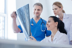 Positive radiologists discussing ct scan result indoors Royalty Free Stock Images