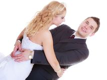 Happy groom and bride posing for marriage photo stock photography