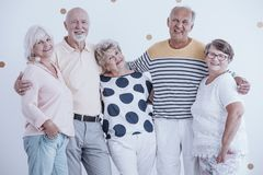 Positive relationship between senior people. Hugging each other Royalty Free Stock Photos