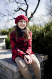 Positive school age girl is in the park Royalty Free Stock Photos