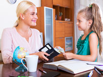 Positive schoolgirl asking money Stock Images