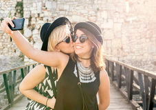 Positive selfie. Two positive girls doing selfie with happy faces,selective focus Stock Photography