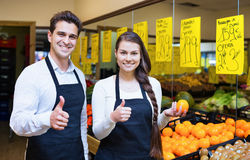 Positive sellers offering good price for fruits Stock Photos