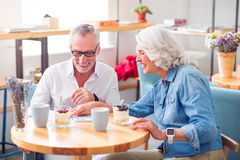 Positive senior couple reading newspaper Stock Photo