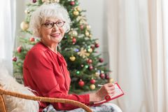 Positive senior female is expressing happiness in holiday royalty free stock photography