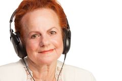 Positive senior in headphones Royalty Free Stock Images