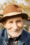 Positive senior man in hat Stock Image