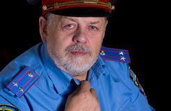 Positive senior man in police uniform Royalty Free Stock Image