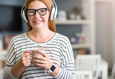 Positive senior woman listening to music Royalty Free Stock Photography