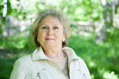 Positive senior woman outdoors Royalty Free Stock Images