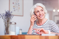 Positive senior woman talking on cell phone Stock Photography