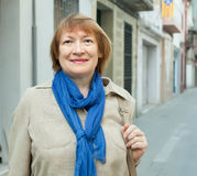 Positive senior woman at town street Royalty Free Stock Photography