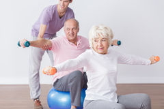 Positive seniors at fitness studio Stock Image