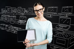 Positive shop assistant selling electronics Stock Photography