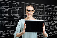 Positive shop assistant selling tablets Royalty Free Stock Photography