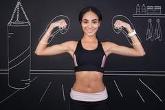 Positive slim woman enjoyign box training Royalty Free Stock Photography