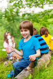Positive small boy holding stick with marshmallows Stock Photography