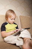 Positive small boy with tablet computer Stock Images