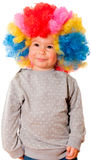 Positive smile. Positive little baby with clown wig on head Royalty Free Stock Image