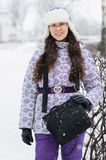 Positive smile woman in winter snowfall Stock Images