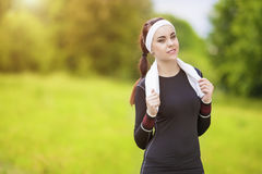 Positive Smiling Caucasian Fit Woman With Towel on Neck Standing Royalty Free Stock Image