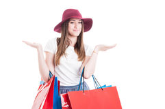 Positive smiling female with shopping bags holding her hands out Stock Image
