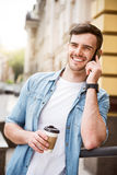 Positive smiling man talking on cell phone Royalty Free Stock Images