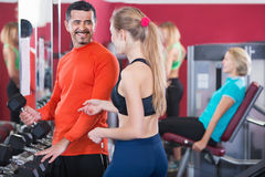 Positive smiling people  weightlifting training in health club. Positive smiling people  weightlifting training in modern health club Royalty Free Stock Photo