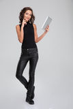 Positive smiling woman using tablet Stock Photography