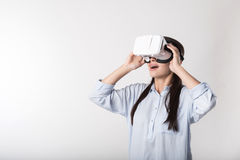 Positive smiling woman using virtual reality glasses Royalty Free Stock Photography