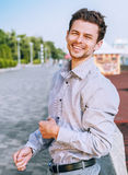 Positive smiling young man outdoor portrait Royalty Free Stock Image