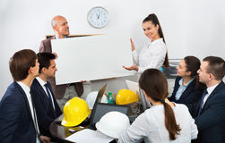 Positive spirited  colleagues discussing new development plan Stock Image