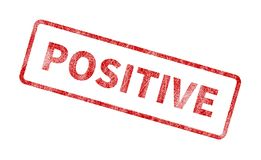 Positive Stamp - Red Grunge Seal. Rubber stamp isolated on white background Stock Photos